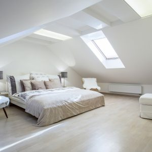 Double bed with a lot of cushions in luxury apartment