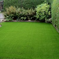 homeguide-new-artificial-turf-installation-in-residential-backyard
